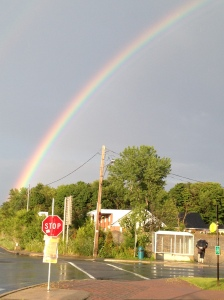 rainbow and bus stop close up